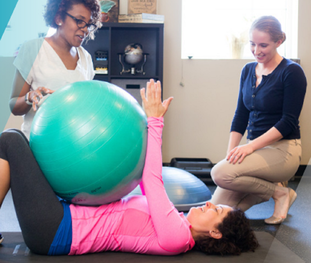 Physical therapists working with patient