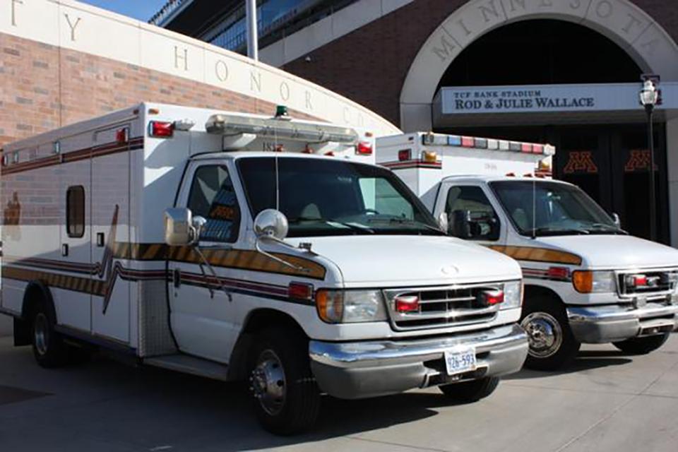 University of Minnesota ambulances parked on campus.