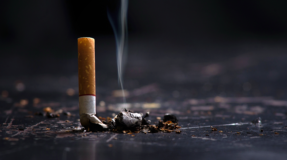A cigarette put out on a floor