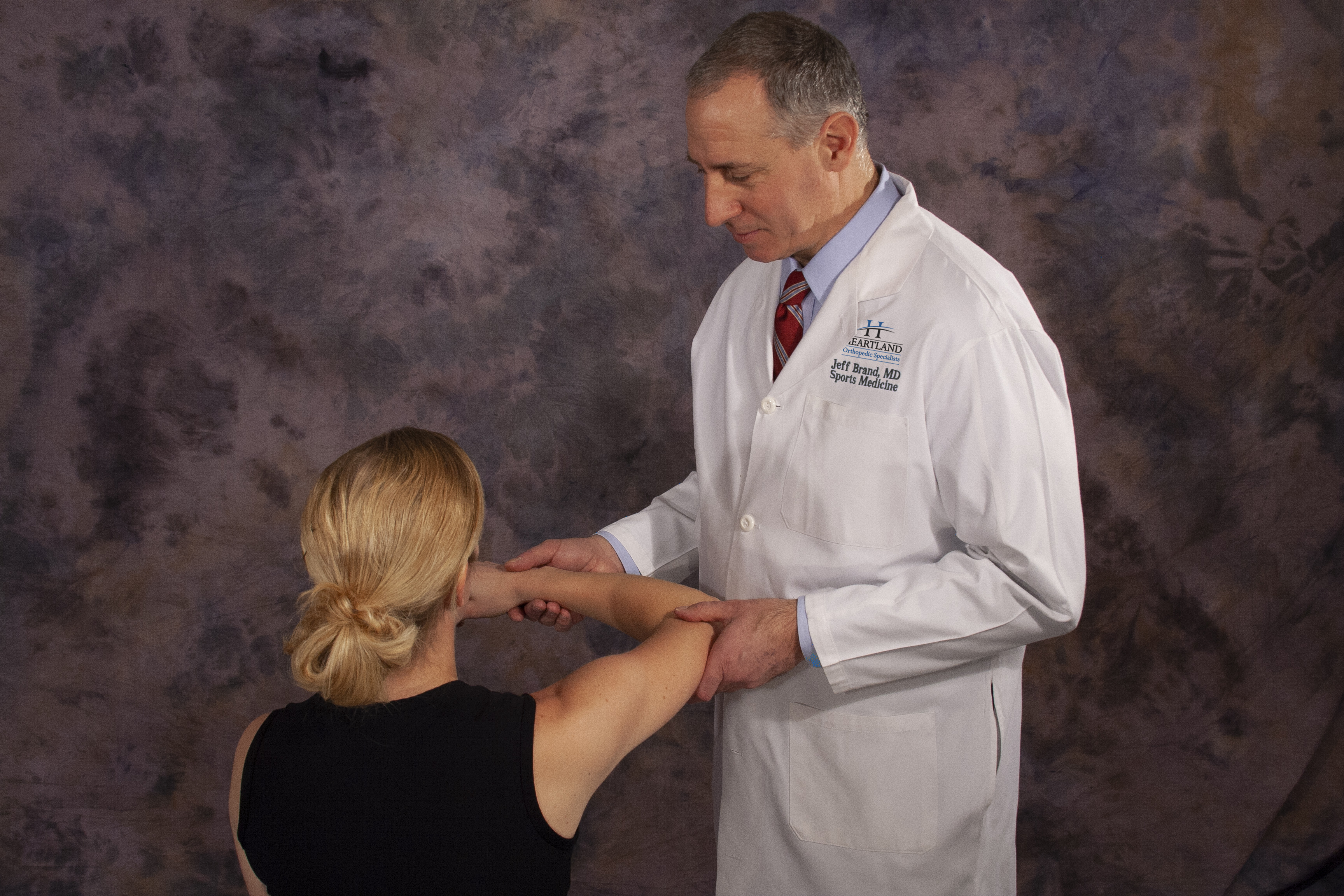 Dr. Brand with a patient