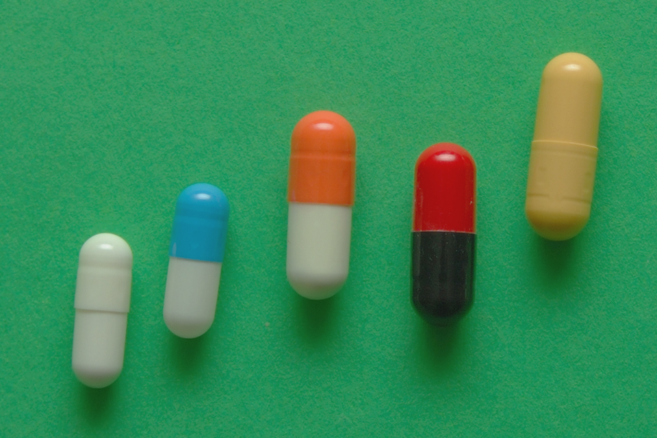 A row of pills trending upward in a line.