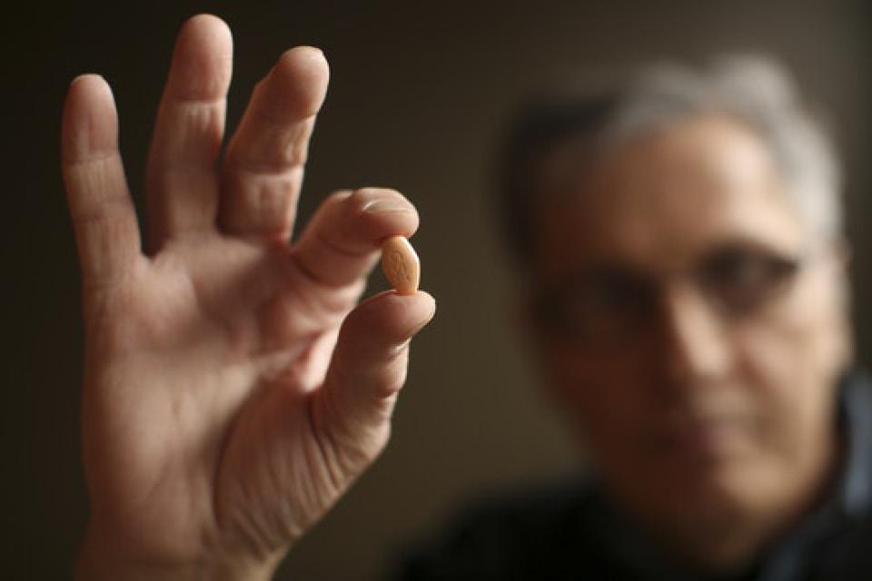 man hold a prescription pill