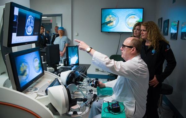 Garnette Sutherland, MD, demonstrating neuroArm technology