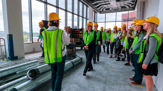 Group of people touring the HSEC construction
