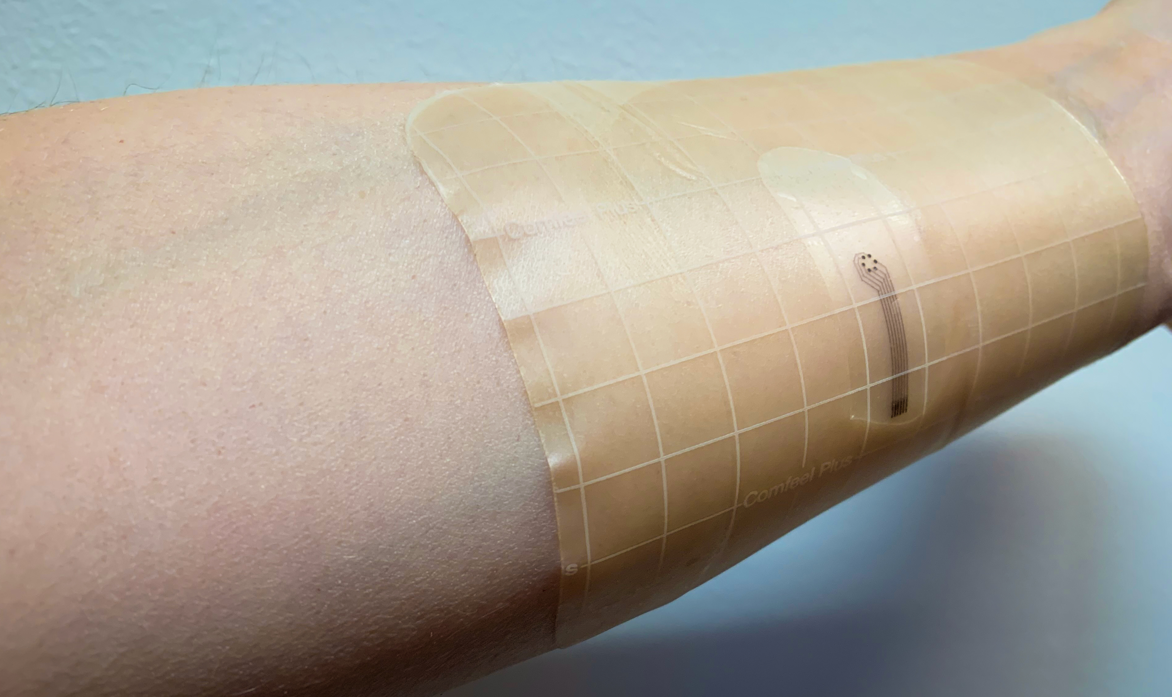 An arm with a bandage on it.