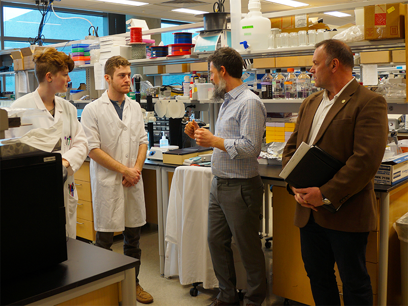 Representative Dave Baker touring a medical lab