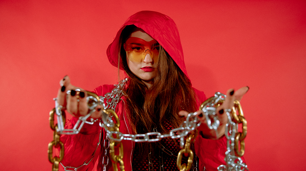 Carmen Aguirre in her video jockey gear, holding chains