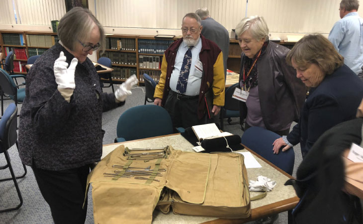 Mary Jo Connolly, M.D., examines historical medical tools