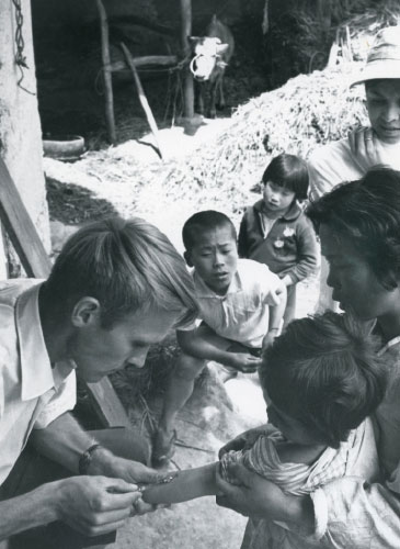 Phillip Peterson, M.D., shown giving a tuberculosis patch test to a child