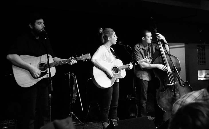 Matt Donoghue (far right) performs with  his Lowland Lakers bandmates, Nate Case  and Haley Rydell, at The Amsterdam Bar  and Hall in downtown St. Paul.