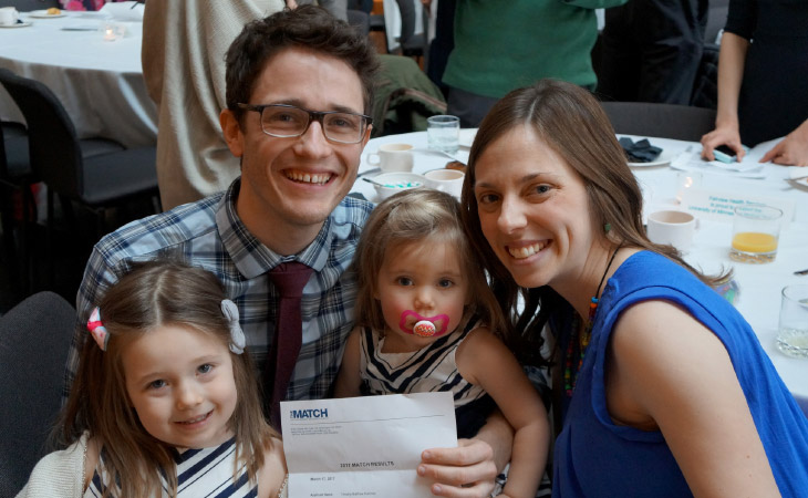 Tim Kummer (right), with  his wife, Nicole, and their daughters, and Tarissa Lai  (far right) will be part of the emergency medicine residency  program at Hennepin County Medical Center.