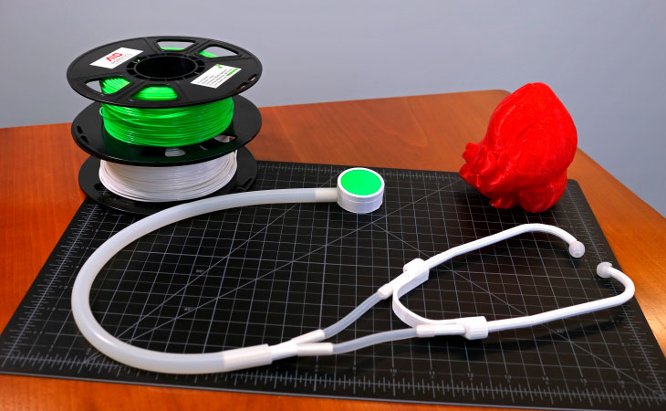 Photograph of a stethoscope and PLA 3D-printing material