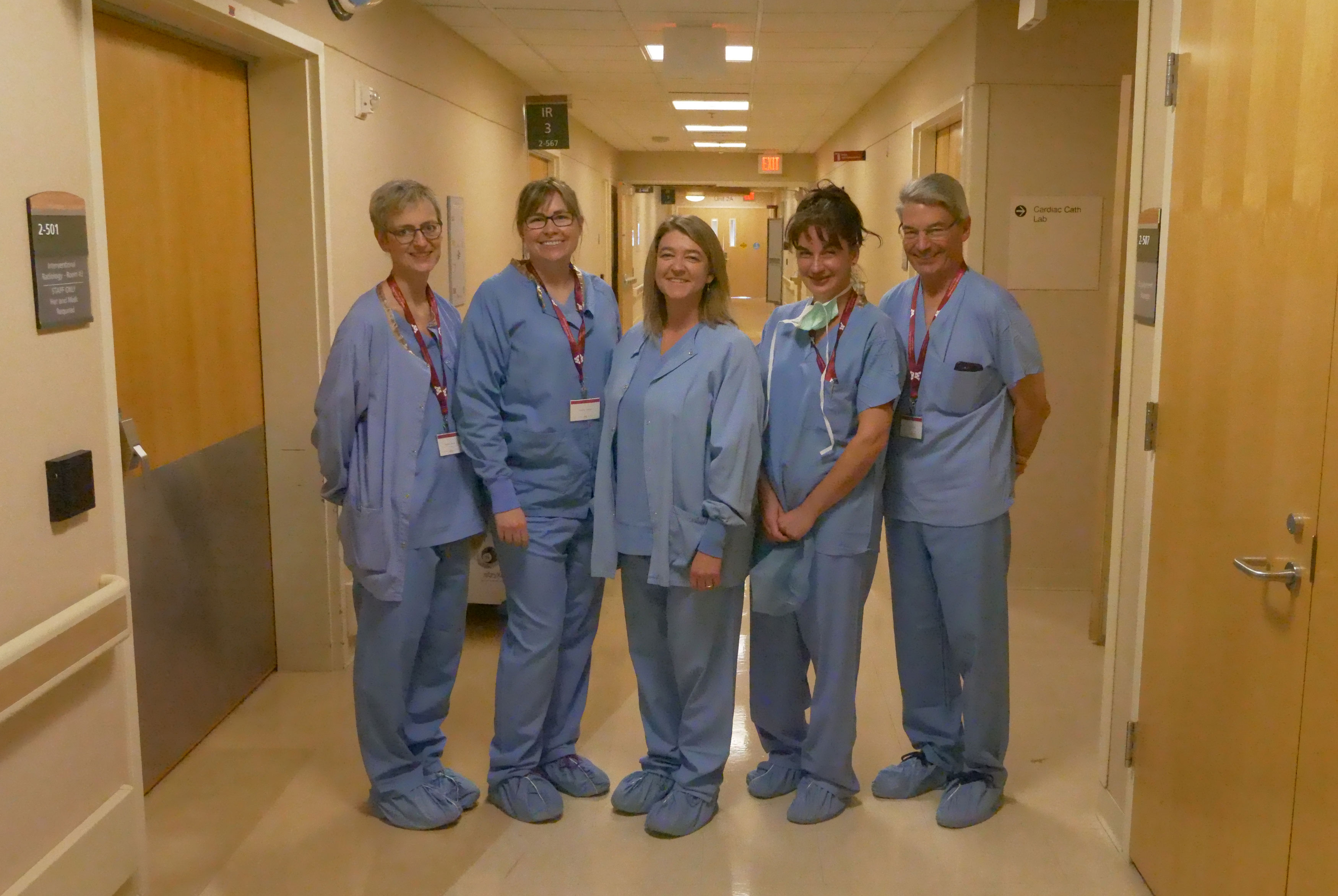 A group of medical technology professionals standing together.