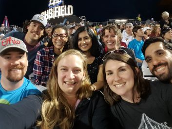 Program members at a St. Paul Saints baseball game.