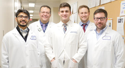 5 residents in white coats