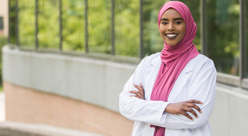 female medical student in white coat