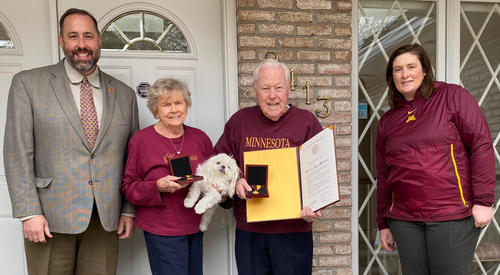 Michael LuBrant, director of the Program of Mortuary Science, presents Kay and Bill McReavy with the Regents Award