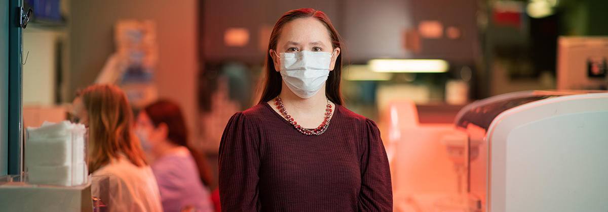 Dr. Amy Karger standing in the lab.