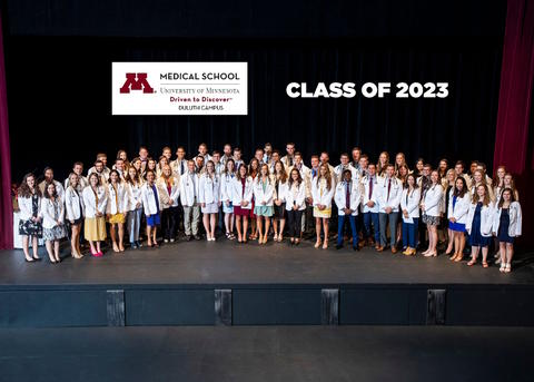 class of 2023 on stage after receiving their white coats