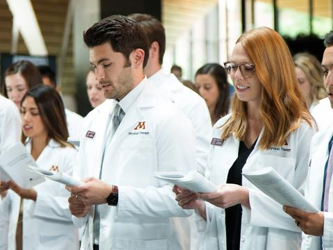 Physical therapy students at white coat ceremony.