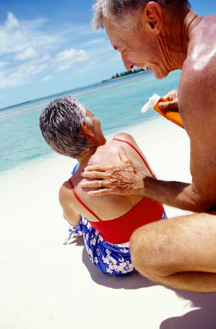 Couple Applying Sunscreen