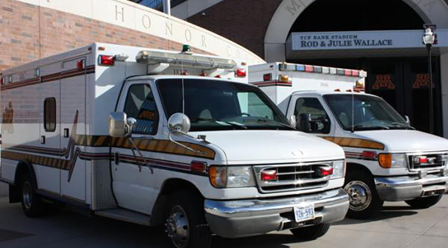 University of Minnesota ambulances parked on campus.
