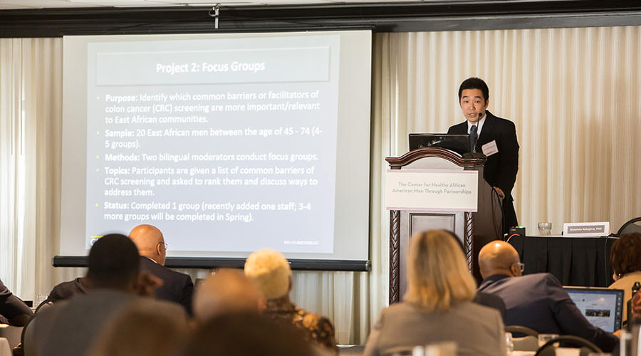 Dr. Nakajima speaking in front of a crowd