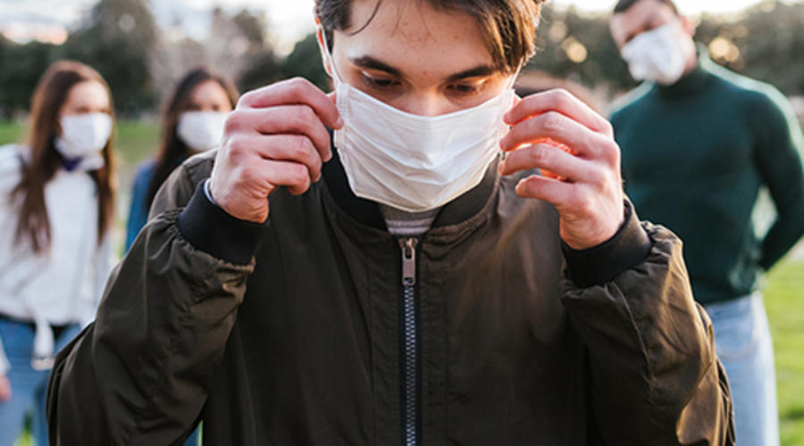 Teenager in face mask