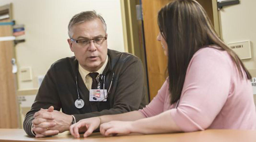 Faculty physician Denny Peterson consults with resident physician Leesa Larson in February at the CentraCare Family Health Center in St. Cloud.