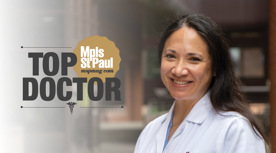 A doctor with the Top Doctors logo