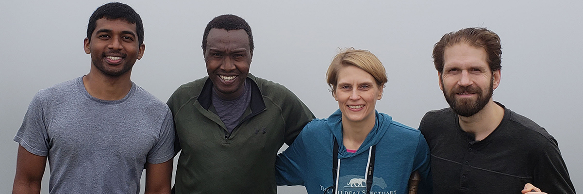 four anesthesiologists hiking in Uganda