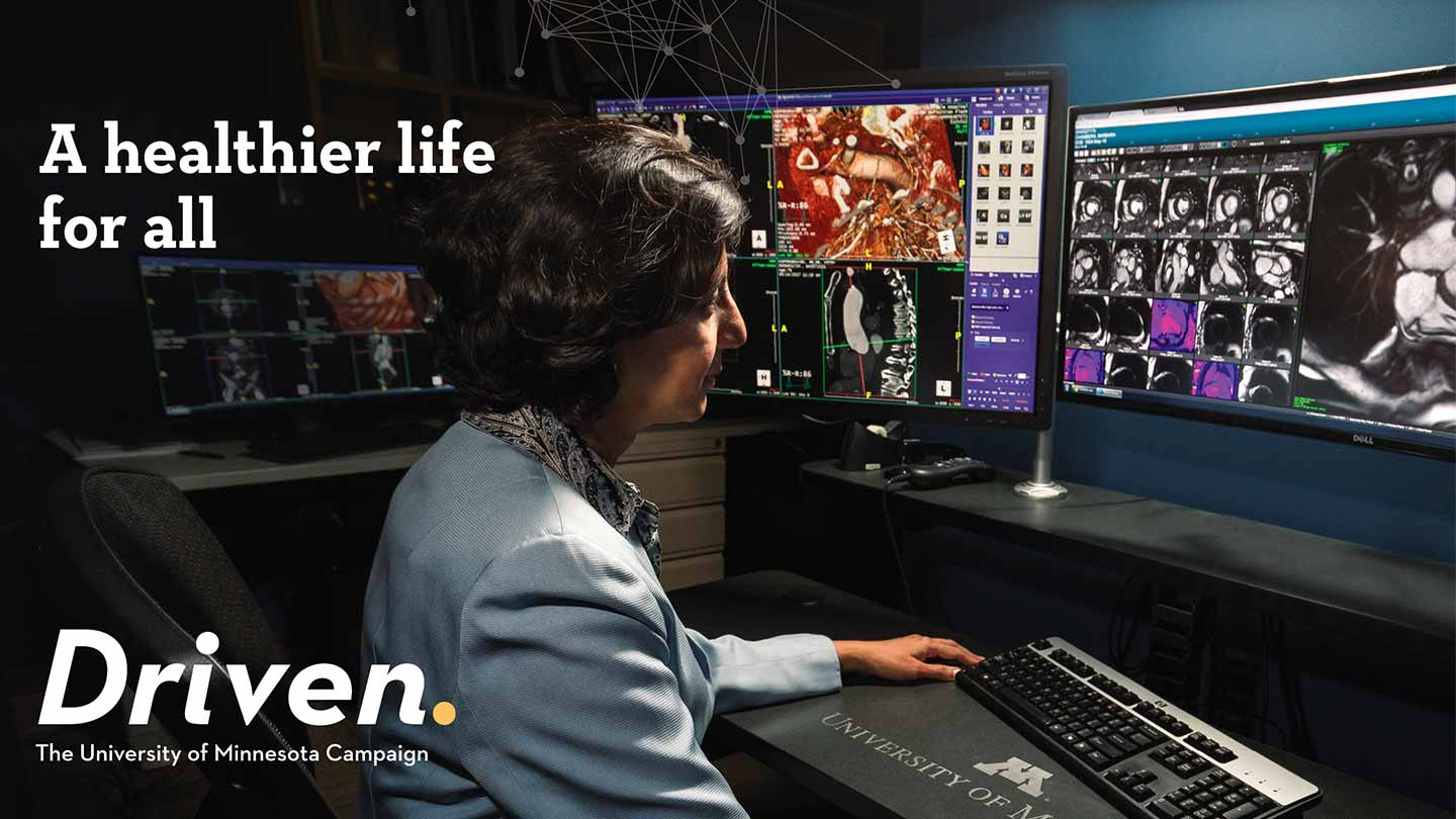 Driven Hero Shot, Woman Doctor looking at computer screens.